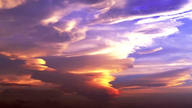 Anvil (incus) cloud in sunset sky video