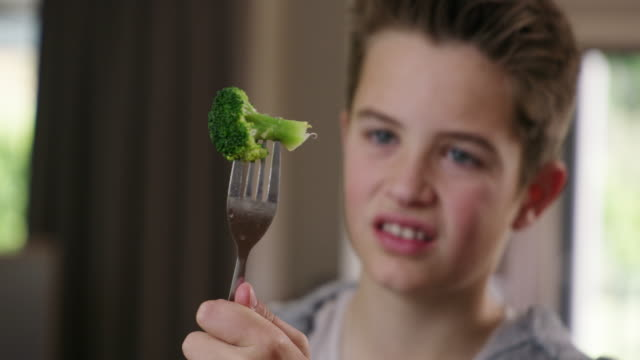 Anything green gives me the greens 4k video footage of a young boy refusing to eat his broccoli at home disgust stock videos & royalty-free footage