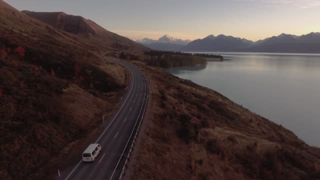 aoraki mount cook and lake pukaki road trip aerial, canterbury high country, south island, new zealand - caravan stock videos & royalty-free footage