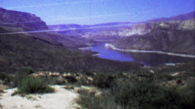 1961: Apache lake reservoir water receding cliff canyon vacation.