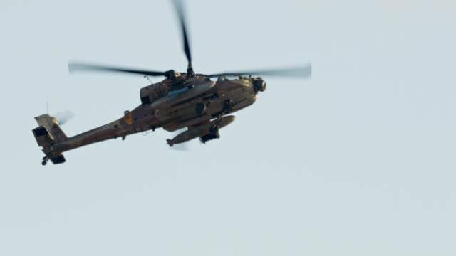 AH-64D Apache Longbow military helicopter attacking targets with canon AH-64D Apache Longbow military helicopter attacking targets with canon us military stock videos & royalty-free footage