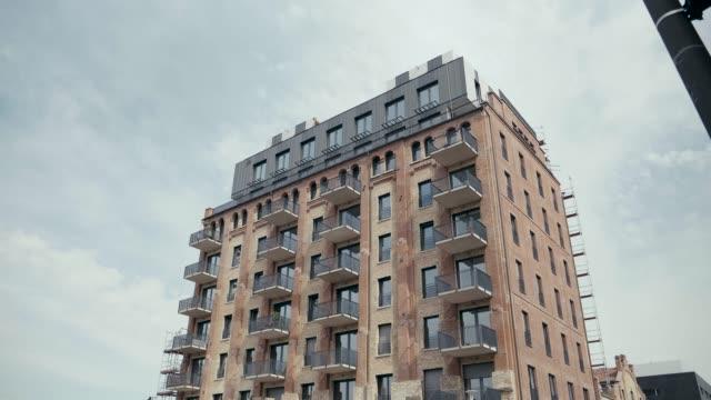 Apartment building establishing shot at day 4K