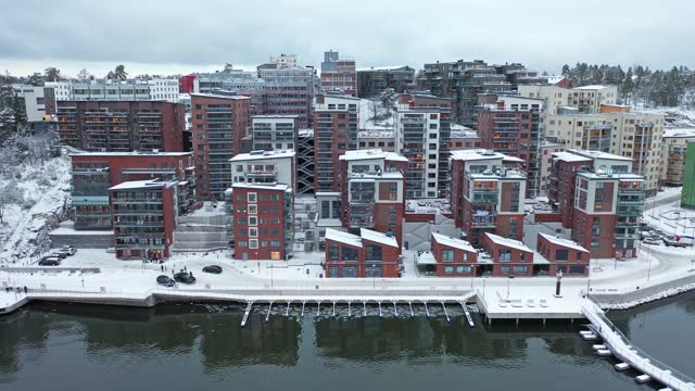 Apartment buildings by the sea Aerial view of modern apartment buildings by the sea in the Nacka municipality outside Stockholm, Sweden. ocean front properties stock videos & royalty-free footage