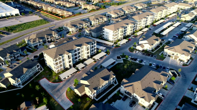 Apartment Complex New Development aerial drone view at Sunset Apartment Complex New Development aerial drone view at Sunset lowering down closer to the rooftops - in Austin , Texas , USA complexity stock videos & royalty-free footage