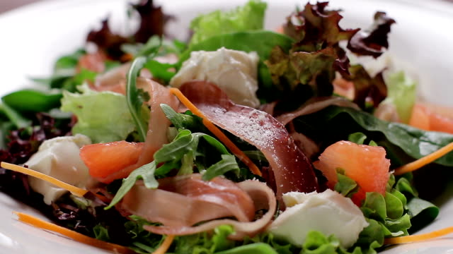 Appetizing salad. Delicious salad sprinkled with parmesan cheese. Close-up of salad ingredients. jerky stock videos & royalty-free footage