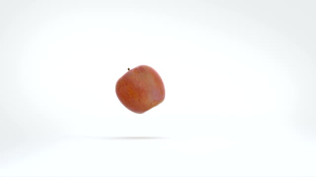 Apple Bouncing A single apple bounces playfully into shot and across the screen, coming to rest. There is space for titles or messages. rolling stock videos & royalty-free footage