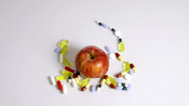 HD STOP-MOTION: Apple Eating Pills video