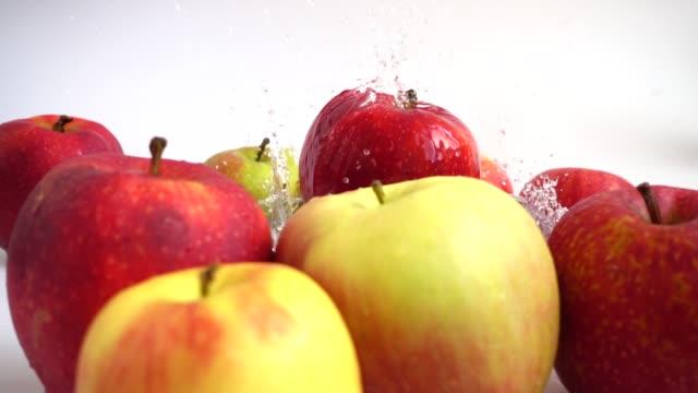 Apple falls in water. Slow motion. video