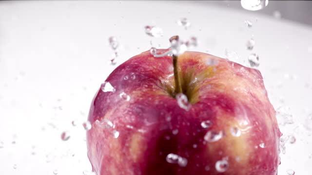 Apple Spinning with Water Splash Super Slow Motion 1000 fps