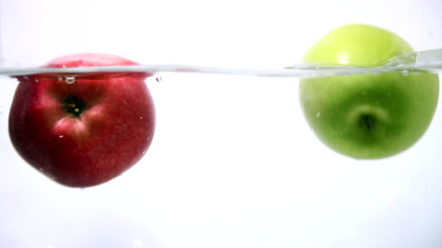 Apples are Splashing Into the Water video