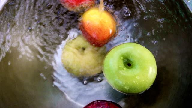 Apples float in water video