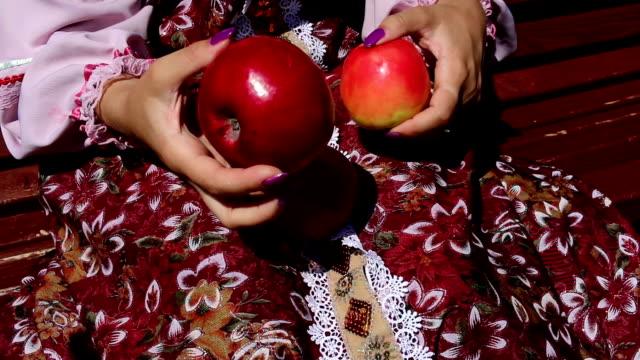 Apples, women's hands, and dress video
