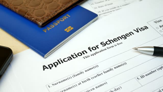 Application for Schengen Visa with passport, apply and permission for foreign country Application form for Schengen Visa to travel or immigration. Visa document with passport, apply and permission for foreign country schengen agreement stock videos & royalty-free footage