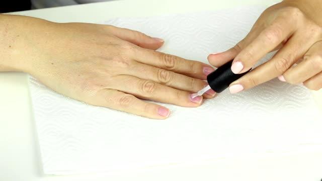 application gel polish base on clean female nails, preparing for color gel varnish video