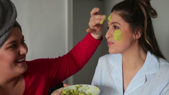 applying an avocado facemask - spa facial stock videos & royalty-free footage