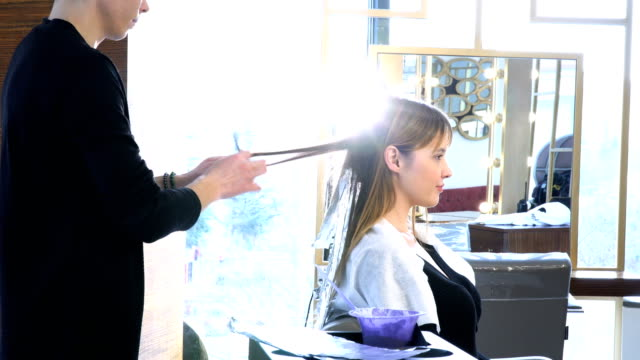 Applying Hair Dye 4K, 29,97p, Real Time highlights hair stock videos & royalty-free footage