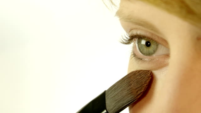 Applying make up on beautiful face video