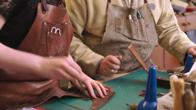 Apprentice In Bespoke Shoemaker Glueing Together Leather video
