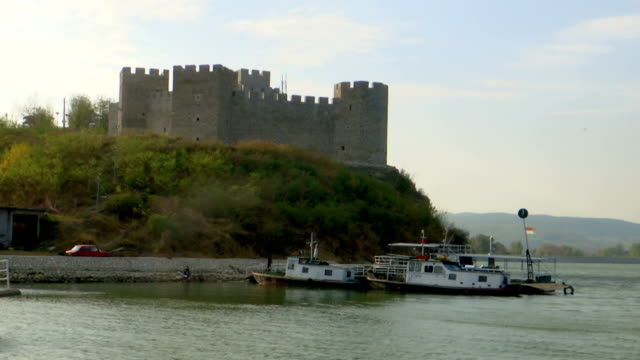 approach from the water of an old fortress tower in the danube - serbia video stock e b–roll