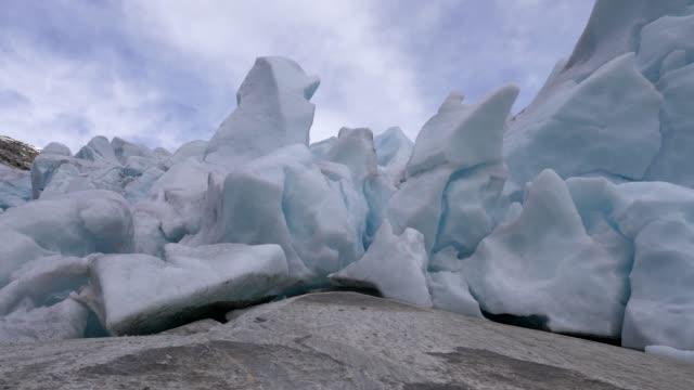 Approaching a giant ice snow glacier. Steadycam shot, 4K