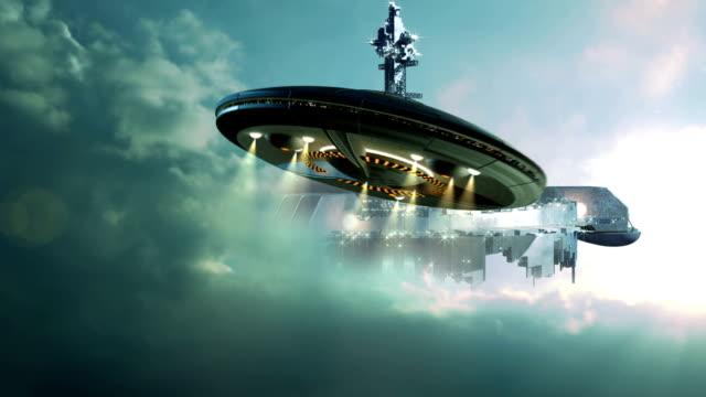 ufo approaching gigantic mother-ship in the clouds - tefat bildbanksvideor och videomaterial från bakom kulisserna