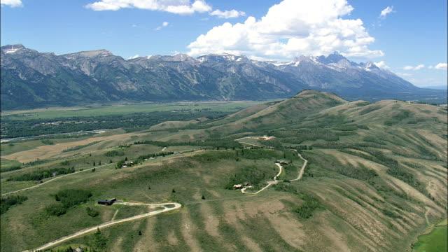 Approaching Teton Village  - Aerial View - Wyoming,  Teton County,  helicopter filming,  aerial video,  cineflex,  establishing shot,  United States video