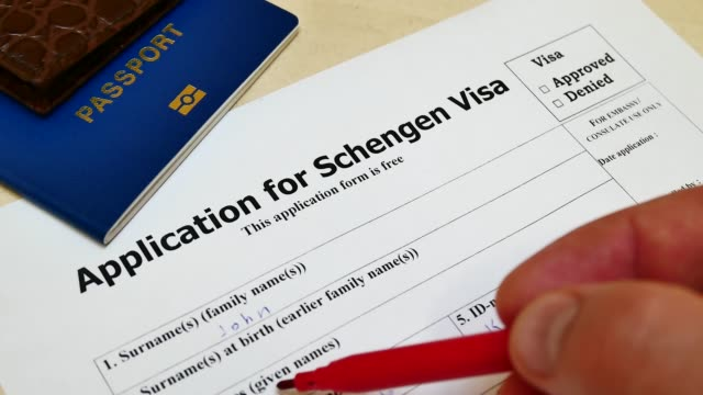 Approved in application for Schengen Visa The decision to grant a visa. Pen voting approved in checkbox in blank Schengen Visa application form with passport and pen. Document with passport, apply and permission for foreigner country schengen agreement stock videos & royalty-free footage