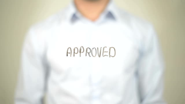 Approved,  Man writing on transparent screen video