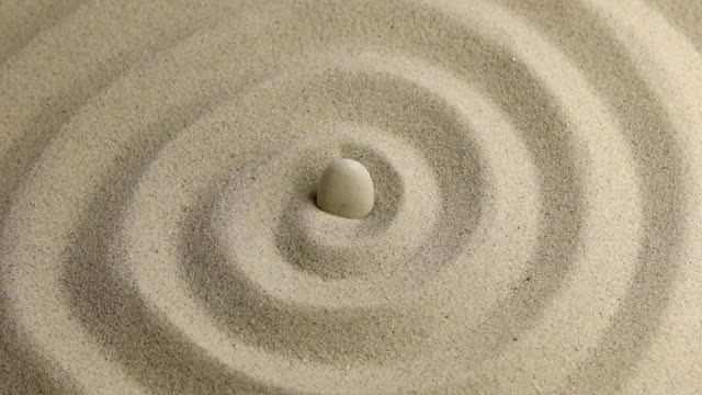 Approximation of white  stone on the sand Approximation of white  stone on the sand, a top view ornamental garden stock videos & royalty-free footage