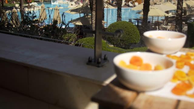 apricot: orange fresh apricots on a pool terrace - albicocco video stock e b–roll