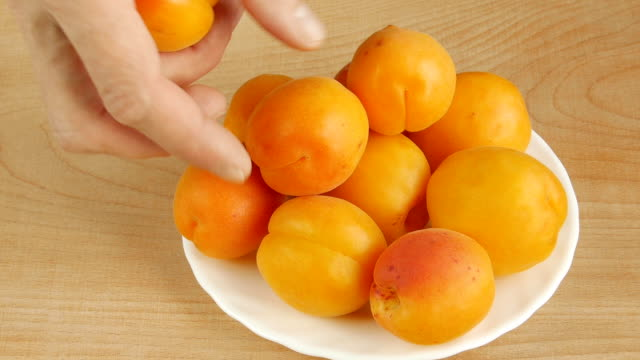 apricots on the table. - albicocca video stock e b–roll