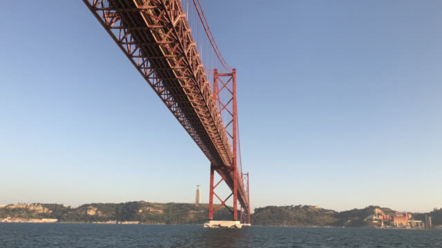 April 25th Brige in Lisbon Video footage of the Tagus River and the April 25th Bridge in Lisbon. suspension bridge stock videos & royalty-free footage
