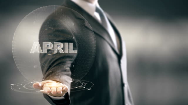 April Businessman Holding in Hand New technologies