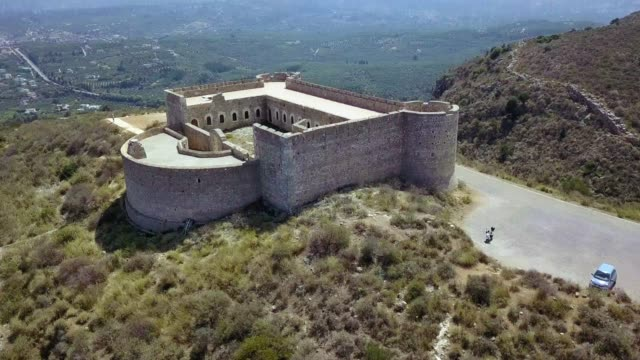 Aptera, Ottoman Fortress Flying over old fortress towards valley and mountain fort stock videos & royalty-free footage
