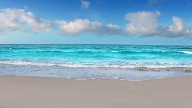 Aqua perfect white sand beach with waves and clouds