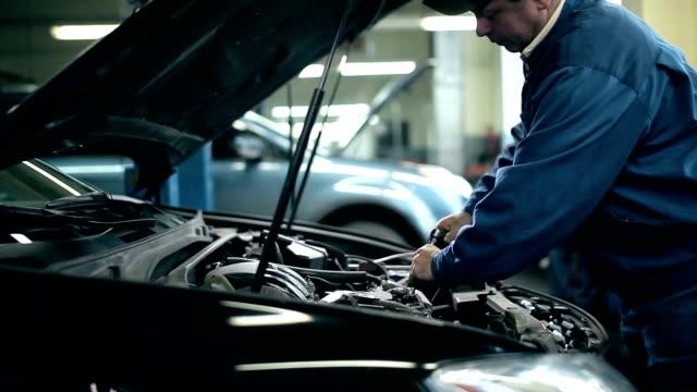 Сar maintenance at repair shop video