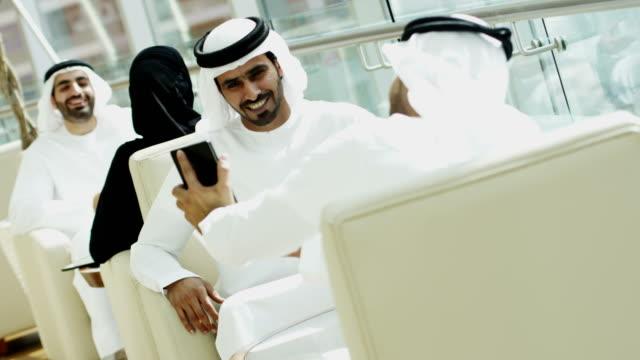 Arab business people national dress using smart phone video