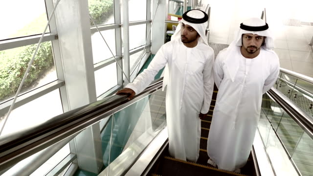 Arab businessmen in traditional clothes - Dubai Subway Station video