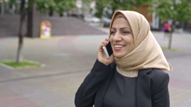 Arab businesswoman talking on phone video
