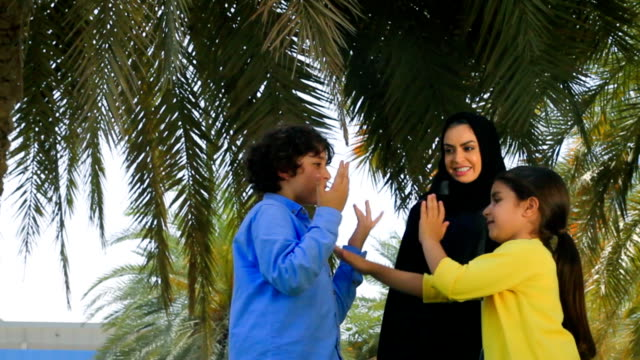 Arab family enjoying in park video