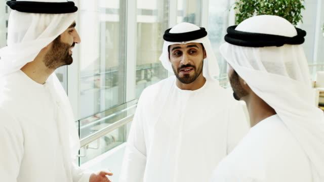 Arab males national dress meeting socially hotel lobby video