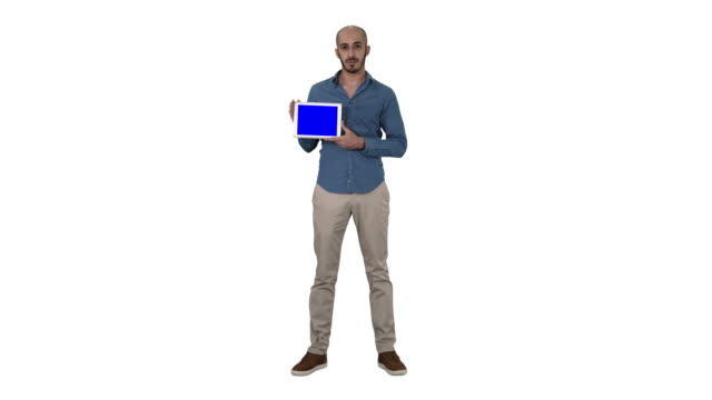 Arab man showing blank tablet screen on white background