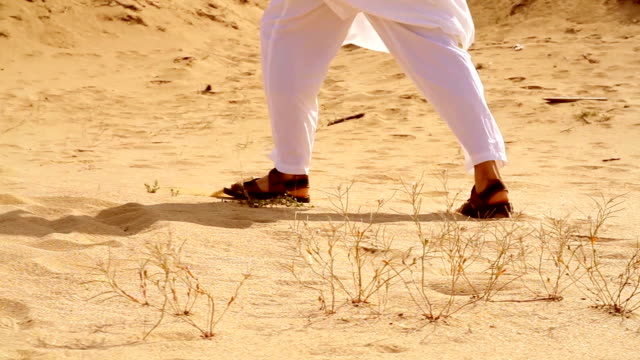 Arab Man Walking in Desert HD video