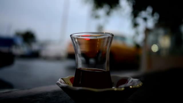 Arabian tea glass with busy city traffic video