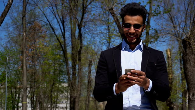 Arabian writer checking e-mail on phone in slow motion video