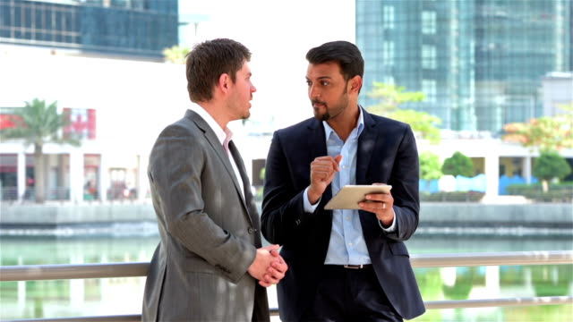 Arabic businessman working with western expat video