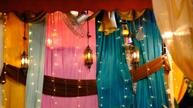 Arabic lamps and lanterns with colorful curtain background