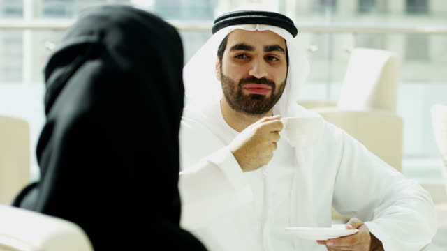 Arabic male female business colleagues downtown city offices video