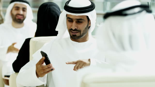 Arabic male female business colleagues using wireless tablet video