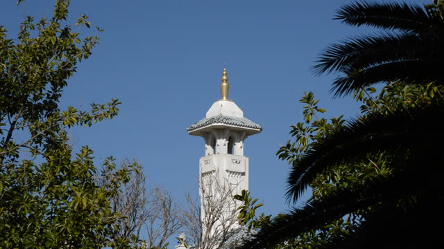 Arabic mosque tower or minaret with yamur a sunny day